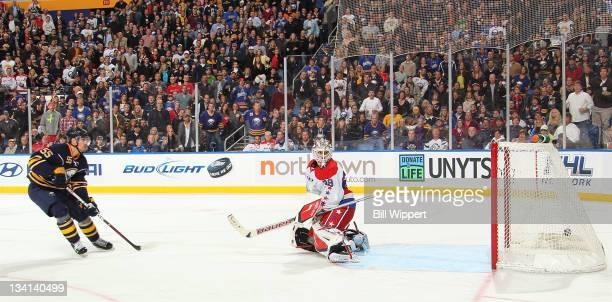 Jochen Hecht of the Buffalo Sabres scores a third period goal against Tomas Vokoun of the Washington Capitals at First Niagara Center on November 26,...