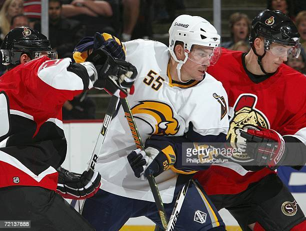 Jochen Hecht of the Buffalo Sabres skates between two Ottawa Senators defenders on October 7, 2006 during their NHL game at the Scotiabank Place in...