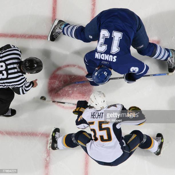 Jochen Hecht of the Buffalo Sabres takes a second period faceoff against Mats Sundin of the Toronto Maple Leafs on November 9, 2007 at HSBC Arena in...