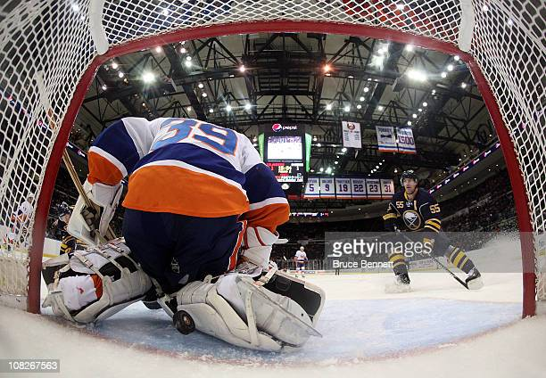Jochen Hecht of the Buffalo Sabres watches a shot by teammate Tyler Ennis elude Rick DiPietro of the New York Islanders at 458 of the second period...