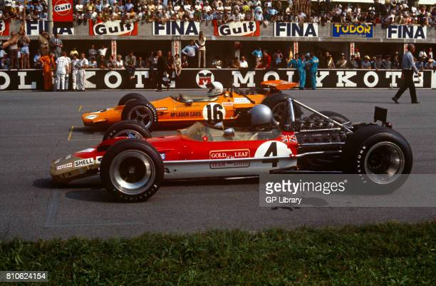Jochen Rindt in a Lotus 49B and 2nd Denny Hulme in a McLaren M7A at Monza the Italian GP Start Grid Italy