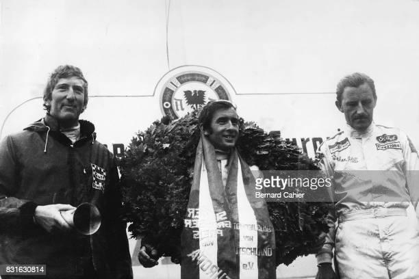 Jochen Rindt Jackie Stewart Graham Hill Grand Prix of Germany Nurburgring 01 August 1965 Jackie Stewart on the highest step of the winners podium...