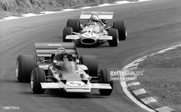 Jochen Rindt of Austria drives the Gold Leaf Team Lotus Lotus 72C Ford V8 ahead of Jack Brabham of Australia driving the Brabham Racing Organisation...