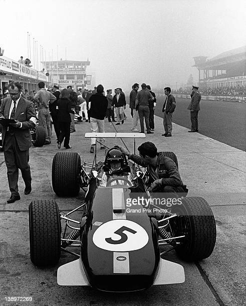 Jochen Rindt of Austria sits aboard the Brabham Racing Organisation Brabham BT26 Ford V8 on pit lane with his mechanic Ron Dennis before the start of...