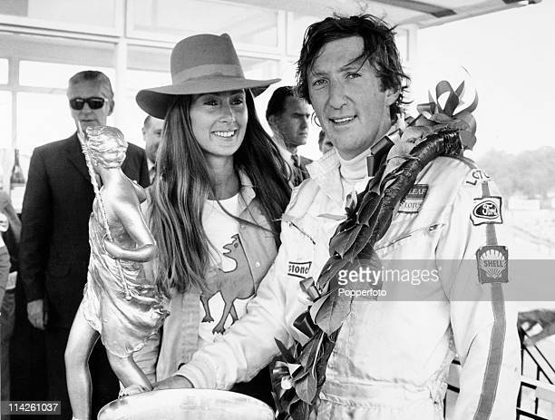 Jochen Rindt of Austria winner of the British Grand Prix at Brands Hatch with his wife Nina the trophy and laurel wreath on 18th July 1970