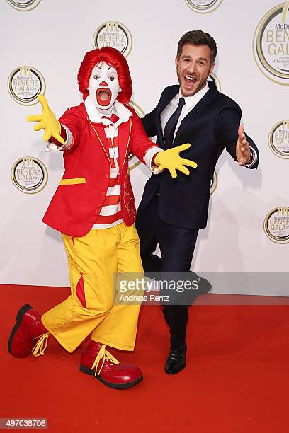 Jochen Schropp and Ronald McDonald attend the McDonald's charity gala on November 13 2015 in Cologne Germany