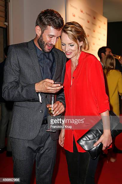 Jochen Schropp and Simone Hanselmann attend the Tiffany & Gala Host 'Streetstyle Meets Red Carpet' Event on October 08, 2014 in Berlin, Germany.