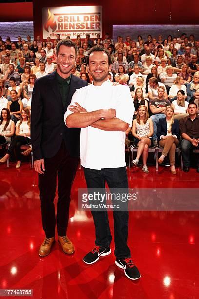 Jochen Schropp and Steffen Henssler attend the 'Grill den Henssler die neue Kocharena' Photocall at Coloneum on August 23 2013 in Cologne Germany
