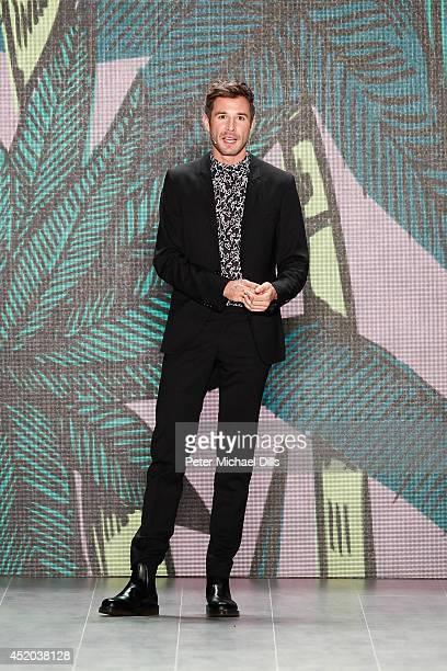 Jochen Schropp speaks at the Opening Night by Grazia fashion show during the MercedesBenz Fashion Week Spring/Summer 2015 at Erika Hess Eisstadion on...