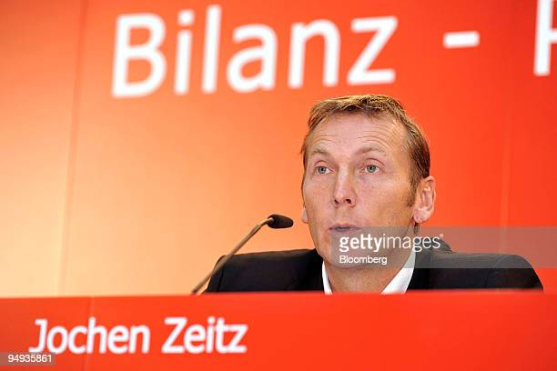Jochen Zeitz chief executive officer of Puma AG poses in front of the Puma logo at the company's news conference in Nuernberg Germany on Wednesday...