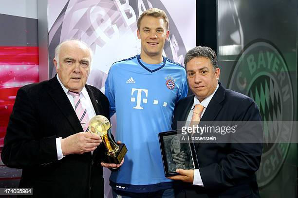Jochen Zwingmann and Ioannis Daras hands over the AIPS 'Player of the Year 2014' award to Manuel Neuer of FC Bayern Muenchen on May 20 2015 in Munich...