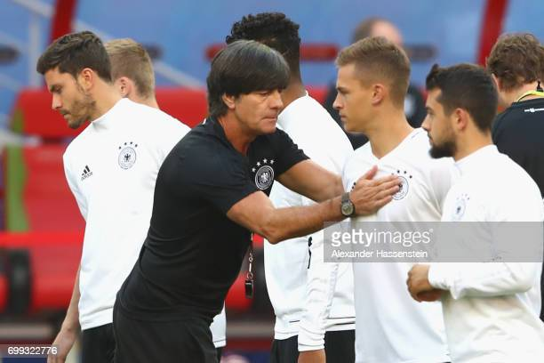 Jochim Loew, head coach of team Germany reacts to his player Joshua Kimmich during a team Germany training session at Kazan Arena on June 21, 2017 in...