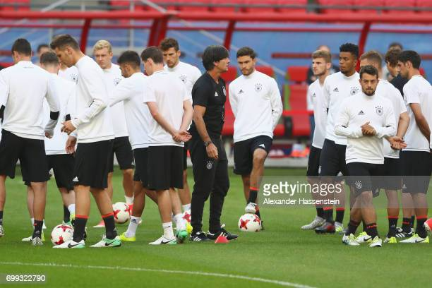 Jochim Loew, head coach of team Germany talks to his players prior to a team Germany training session at Kazan Arena on June 21, 2017 in Kazan,...