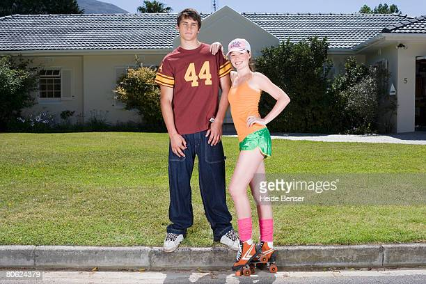Jock and Teenage Girl in Front of Suburban Home