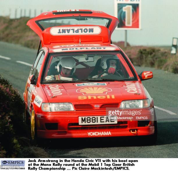 Jock Armstrong in the Honda Civic VTI with his boot open at