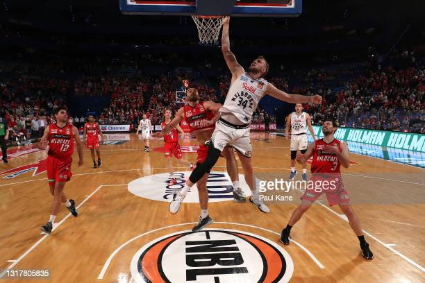 Jock Landale of Melbourne United goes to the basket against John Mooney of the Wildcats during the round 18 NBL match between the Perth Wildcats and...