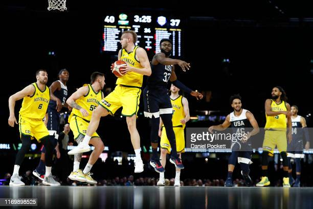 Jock Landale of the Boomers rebounds the ball against Jaylen Brown of the USA during game two of the International Basketball series between the...