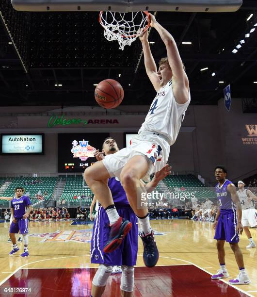 Jock Landale of the Saint Mary's Gaels dunks against Ray Barreno of the Portland Pilots during a quarterfinal game of the West Coast Conference...