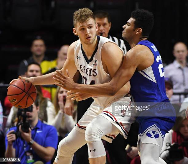 Jock Landale of the Saint Mary's Gaels is guarded by Yoeli Childs of the Brigham Young Cougars during a semifinal game of the West Coast Conference...