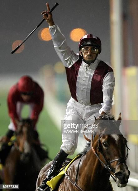 Jockey Ahmad Ajtebi celebrates as he leads US contender Gladiatorus, owned by Emirati Sheikh Mansur bin Mohammed al-Maktoum, to win the Dubai Duty...