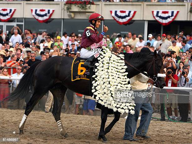 Jockey Alan Garcia atop Da'Tara celebrates with a thumbsup after winning the 140th running of the Belmont Stakes at Belmont Park on June 7 2008 in...