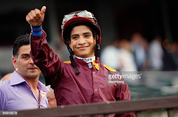 Jockey Alan Garcia gestures after riding Da' Tara to victory at Belmont Park during the running of the 140th Belmont Stakes in Elmont New York US on...