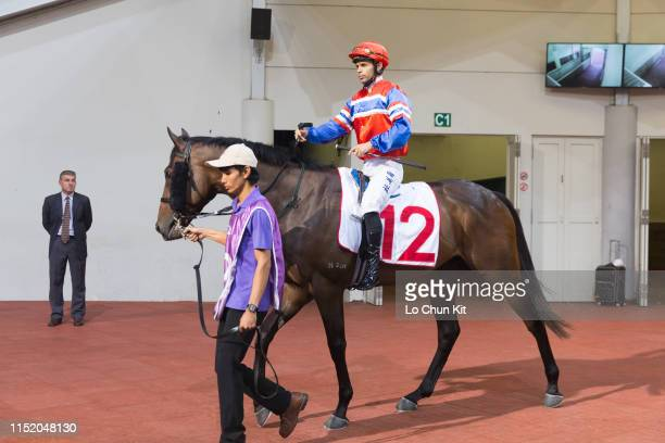 Jockey Aldo Domeyer riding Siam Royal Orchid during Race 8 Singapore Guineas at Kranji Racecourse on May 25 2019 in Singapore