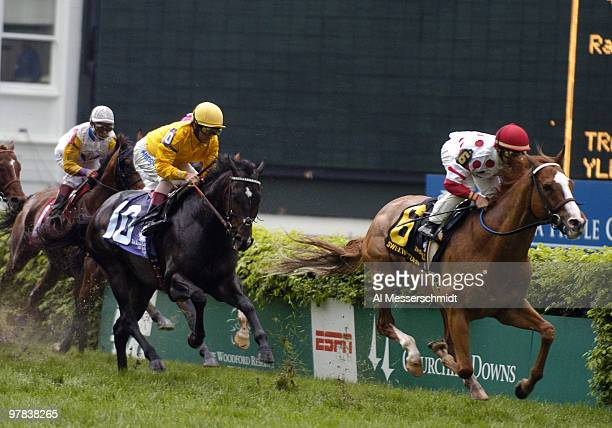 Jockey Alex Solis aboard Burning Sun battles for the lead in the ninth race the Woodford Reserve Turf Classic before the 130th running of the...