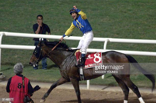 US jockey Alex Solis on Pleasantly Perfect celebrates his victory over fellow American Jerry Bailey on Medaglia d'Oro at the Dubai World Cup 27 March...