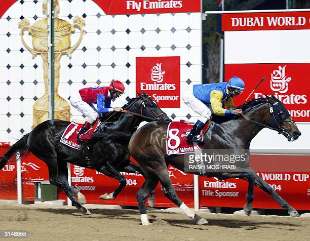 US jockey Alex Solis on Pleasantly Perfect wins ahead of fellow American Jerry Bailey on Medaglia d'Oro at the Dubai World Cup 27 March 2004...