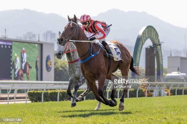 Jockey Alexis Badel riding Explosive Witness wins the Race 3 Bauhinia Sprint Trophy at Sha Tin Racecourse on January 1, 2021 in Hong Kong.