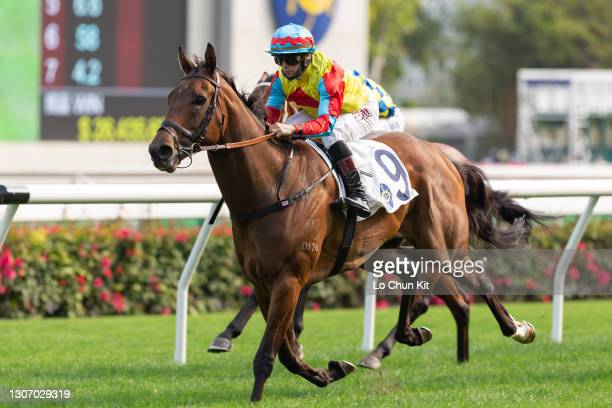 Jockey Alexis Badel riding Wellington wins the Race 7 Lantau Island Handicap at Sha Tin Racecourse on March 13, 2021 in Hong Kong.