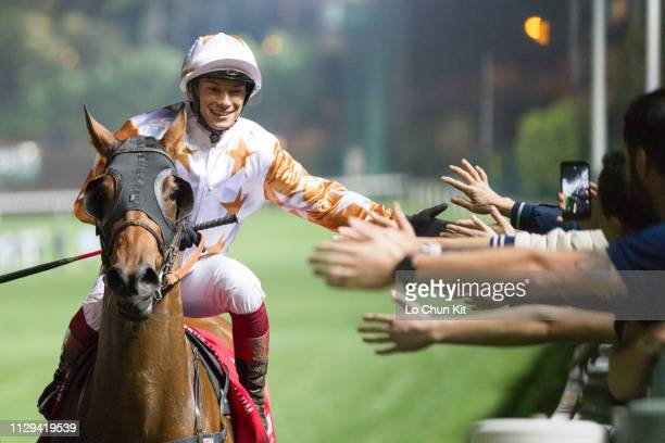 Jockey Alexis Badel riding Wishful Thinker wins the Race 6 The Happy Valley Trophy at Happy Valley Racecourse on February 13 2019 in Hong Kong