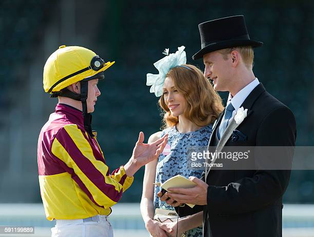 jockey and owners in parade ring - horse racing stock pictures, royalty-free photos & images