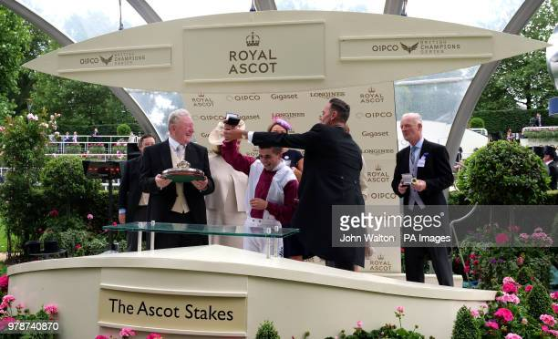 Jockey Andrea Atzeni and trainer Willie Mullins are presented with the trophies by Craig Revel Horwood after winning the Ascot Stakes with...