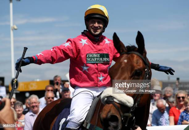 Jockey Andrew Thornton celebrates after winning The Abacus Decorators 'National Hunt' Maiden Hurdle at Uttoxeter Racecourse