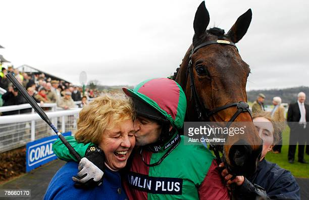 Jockey Andrew Thornton hugs his trainers wife Sally Alner after victory in The Coral Welsh National on Miko De Beauchene at Chepstow Racecourse on...