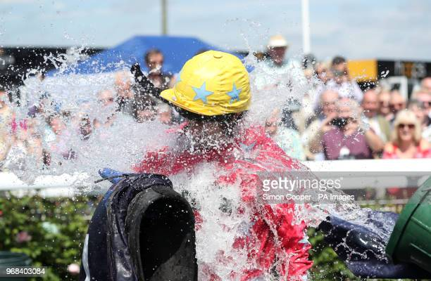 Jockey Andrew Thornton is dowsed in water as he celebrates after winning The Abacus Decorators 'National Hunt' Maiden Hurdle at Uttoxeter Racecourse