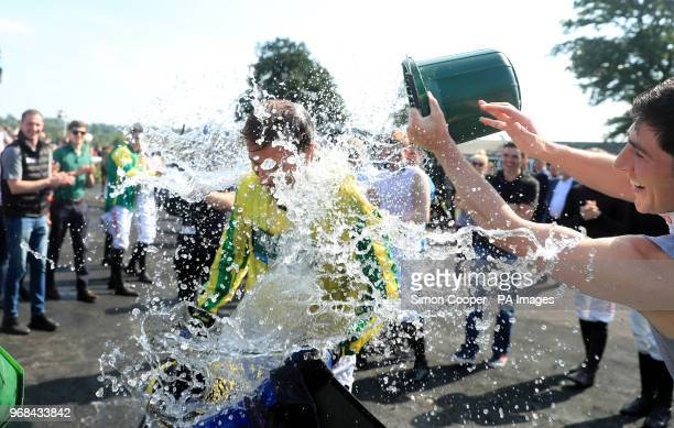 Jockey Andrew Thornton is dowsed in water in the parade ring after his final race as a jockey at Uttoxeter Racecourse PRESS ASSOCIATION Photo Picture...