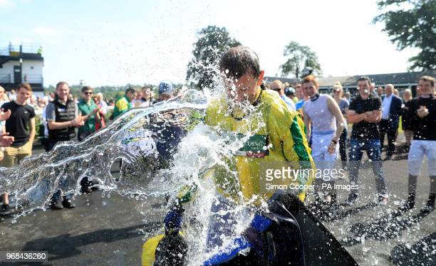 Jockey Andrew Thornton is dowsed in water in the parade ring after his final race as a jockey at Uttoxeter Racecourse
