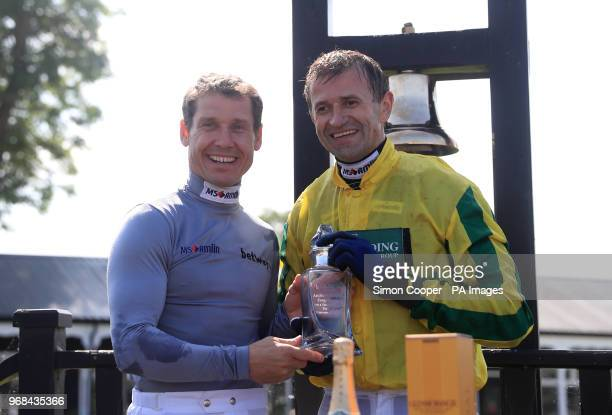 Jockey Andrew Thornton is presented with a trophy in the parade ring after his final race as a jockey by champion jockey Richard Johnson at Uttoxeter...