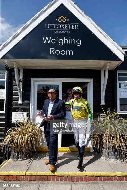 Jockey Andrew Thornton leaves the weighing room with agent Dave Roberts on his last days race riding as he retires after the meeting having ridden...