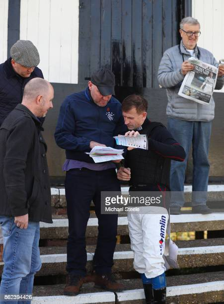Jockey Andrew Thornton studies the card with punters as he returns to the saddle after a ten month injury lay off at Worcester Racecourse on October...