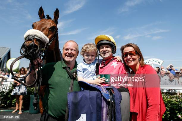 Jockey Andrew Thornton with his son Harry and wife Yvonne after riding Amirr to win The Abacus Decorators 'National Hunt' Maiden Hurdle on his last...