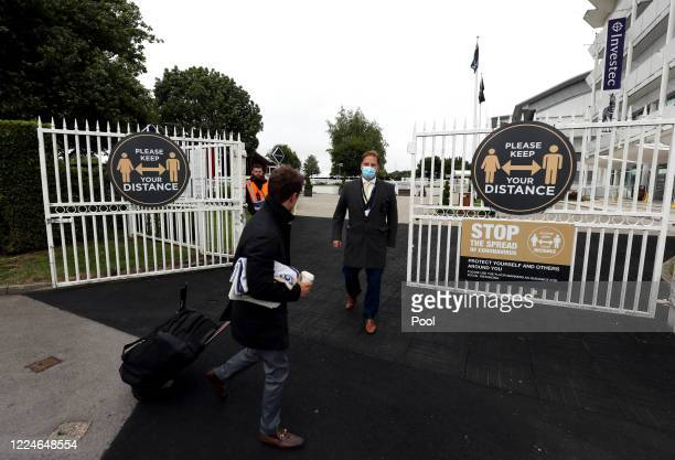 Jockey arrives at Epsom Racecourse on July 04, 2020 in Epsom, England. The famous race meeting will be held behind closed doors for the first time...