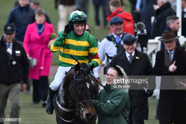 Jockey Barry Geraghty rides Saint Roi as he celebrates after winning the Randox Health County Handicap Hurdle Race during the final day of the...