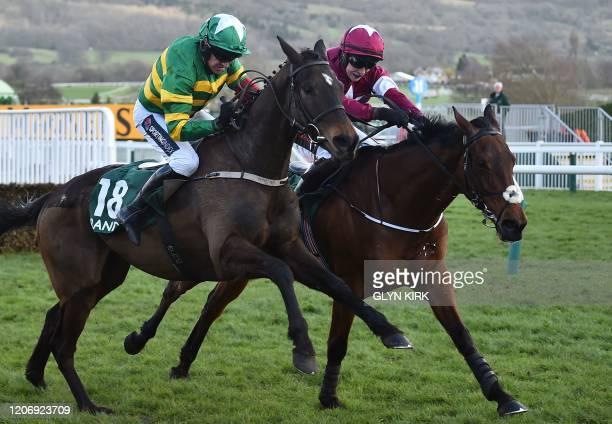 Jockey Barry Geraghty rides Saint Roi to win the Randox Health County Handicap Hurdle Race during the final day of the Cheltenham Festival horse...