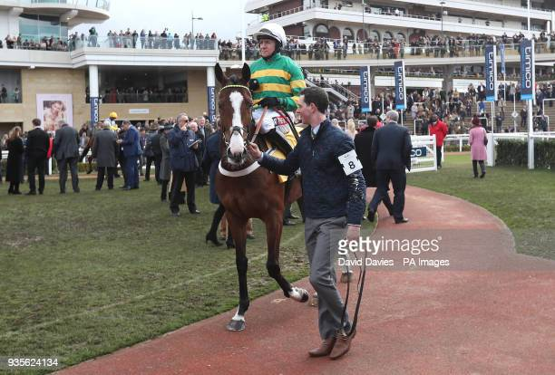 Jockey Barry Geraghty riding Apple's Shakira prior to the JCB Triumph Hurdle during Gold Cup Day of the 2018 Cheltenham Festival at Cheltenham...