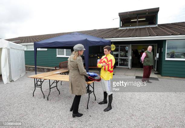 Jockey Ben Jones chats to trainer Emma Lavelle at Exeter Racecourse on October 8, 2020 in Exeter, England.
