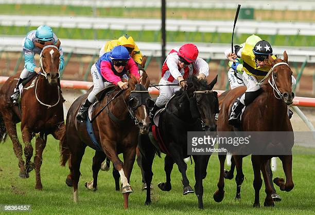 Jockey Ben Knobel rides Miss Chatter to win race Four the Rideability Victoria Plate during The Community Raceday at Flemington Racecourse on April...